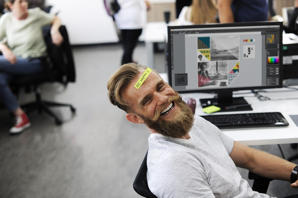 Man Laughing In His Acoustic Workplaces Office